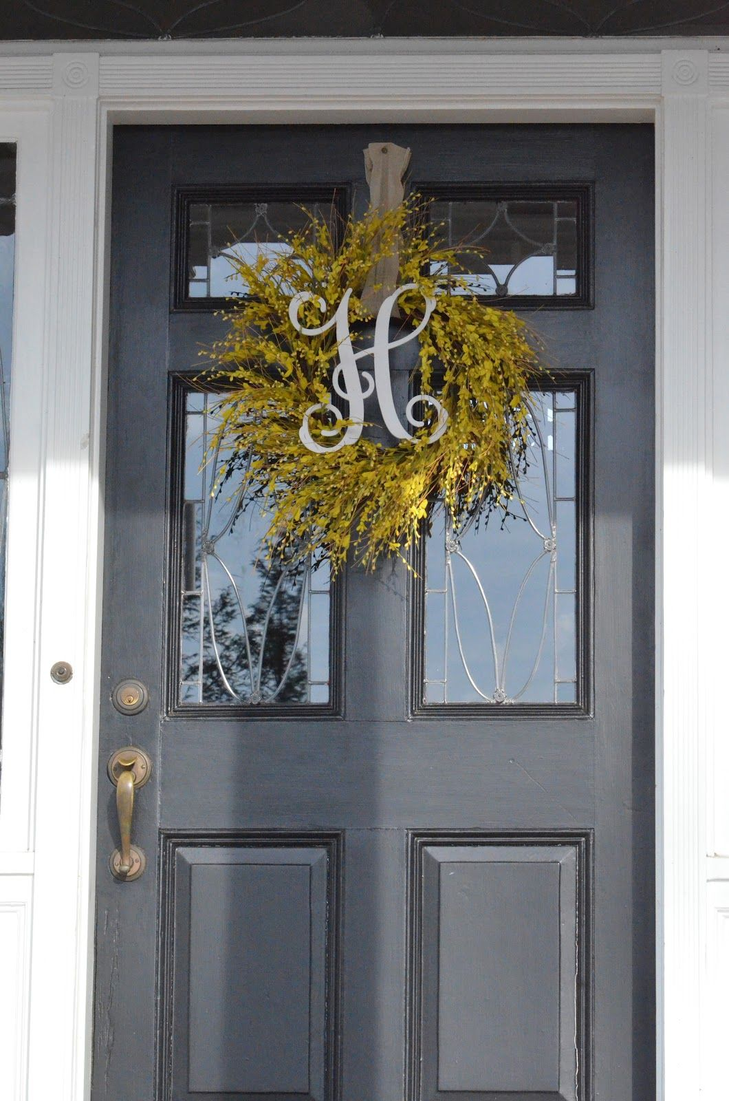 To Do Black Front Door Cute Yellow Wreath And Welcome Applica Front Porch Decorating Black