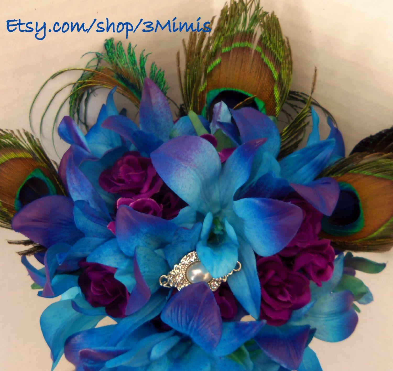 Blue dendrobium orchid bouquet peacock feather wedding bouquet