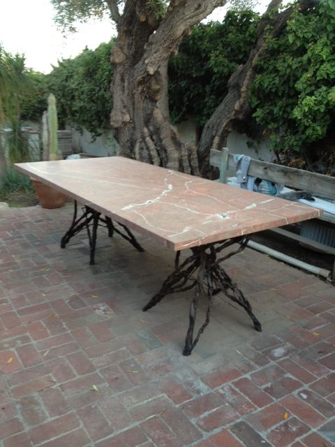 Hand forged vine base outdoor dining table