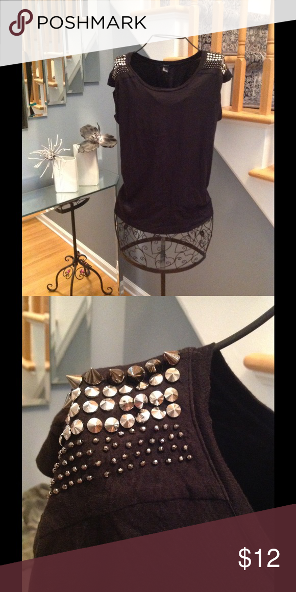 Forever 21 Top Forever 21 black top with studs on the shoulders.  Cute!   Excellent condition! Forever 21 Tops Tees - Short Sleeve