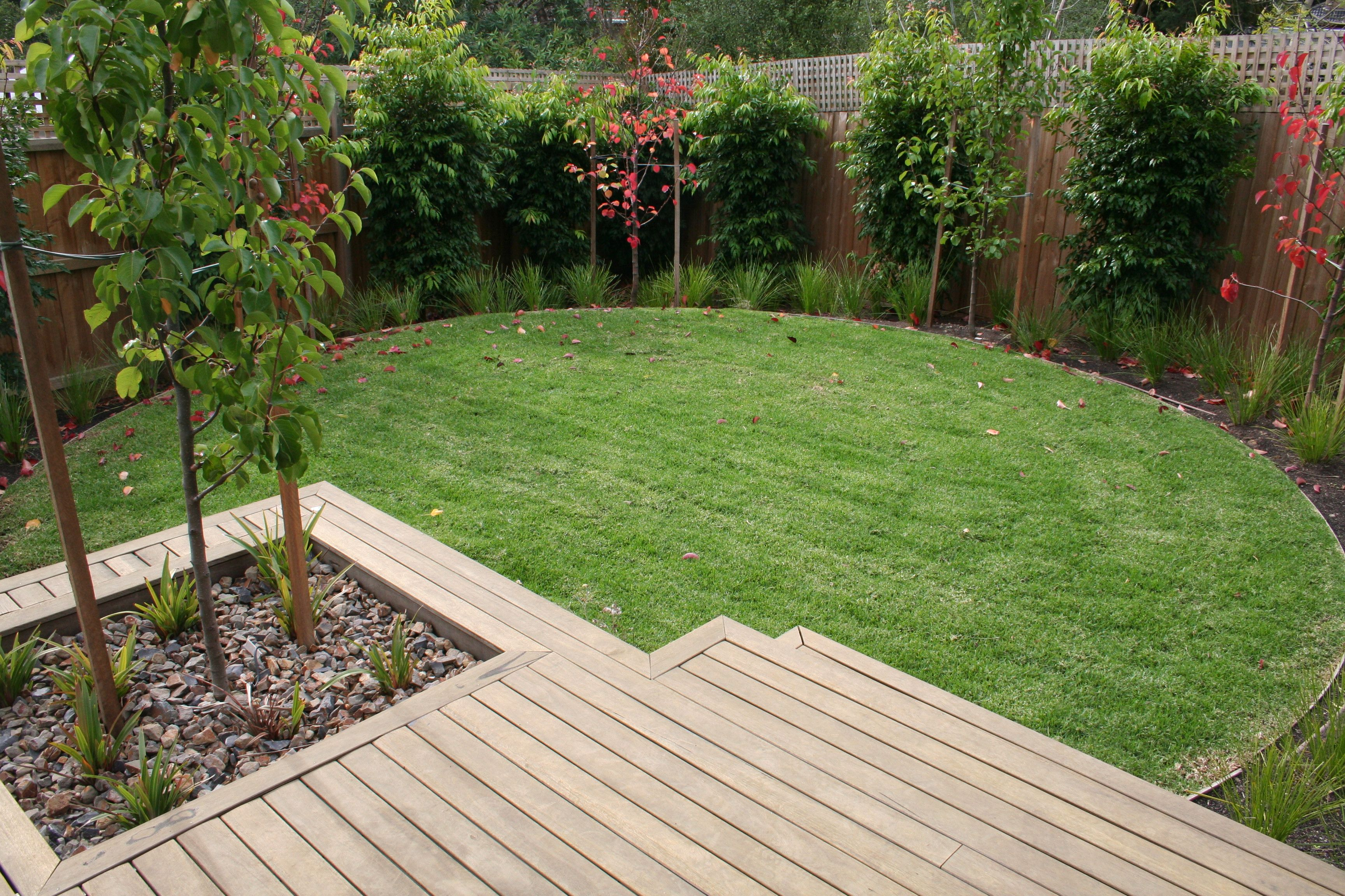 Deck landing with feature ornamental pear tree and for Garden decking and grass