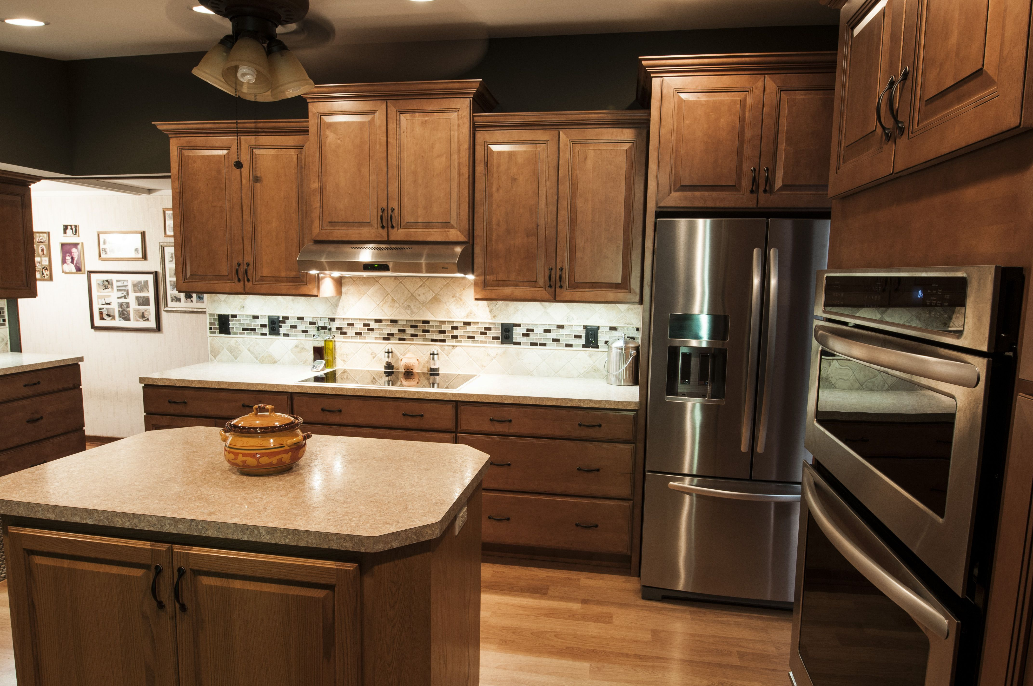 staggered wall cabinets are accentuated by the vaulted ceiling resulting in an open spacious on kitchen cabinets vaulted ceiling id=65435