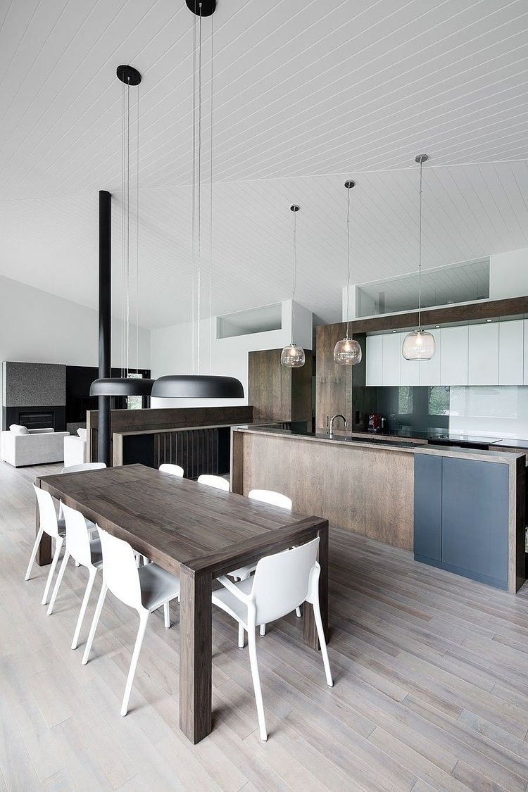 Love the contrast of the dark wood and light ceiling in this kitchen