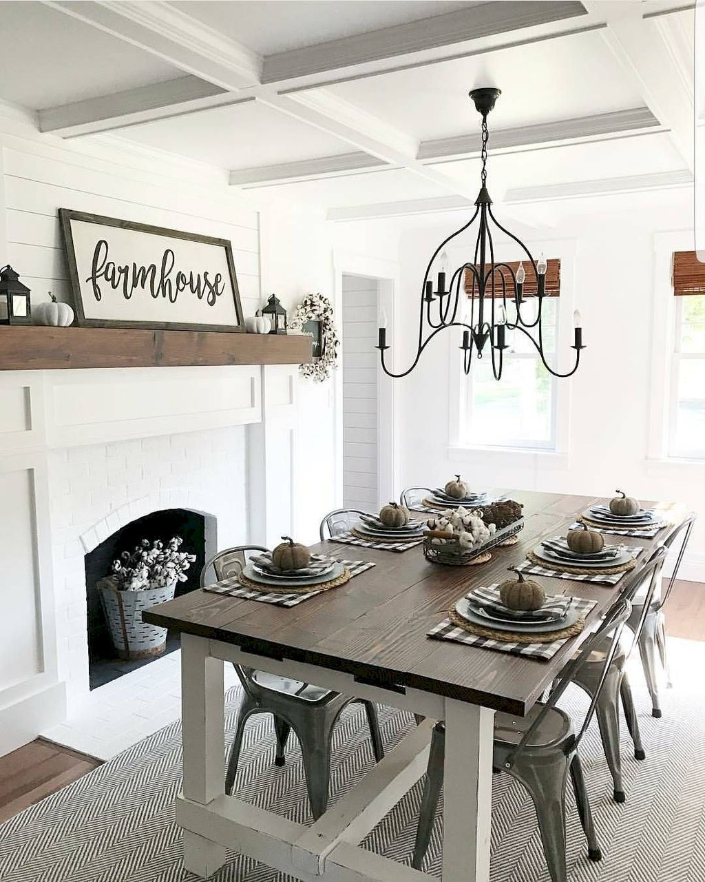 Beautiful white farmhouse style dining room with fireplace