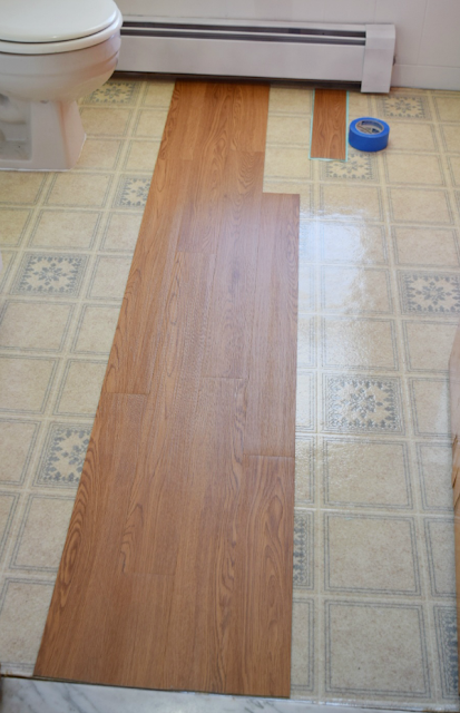 Install Peel And Stick Vinyl Floor Planks In The Bathroom Installing Vinyl Plank Flooring Vinyl Flooring Kitchen Diy Flooring