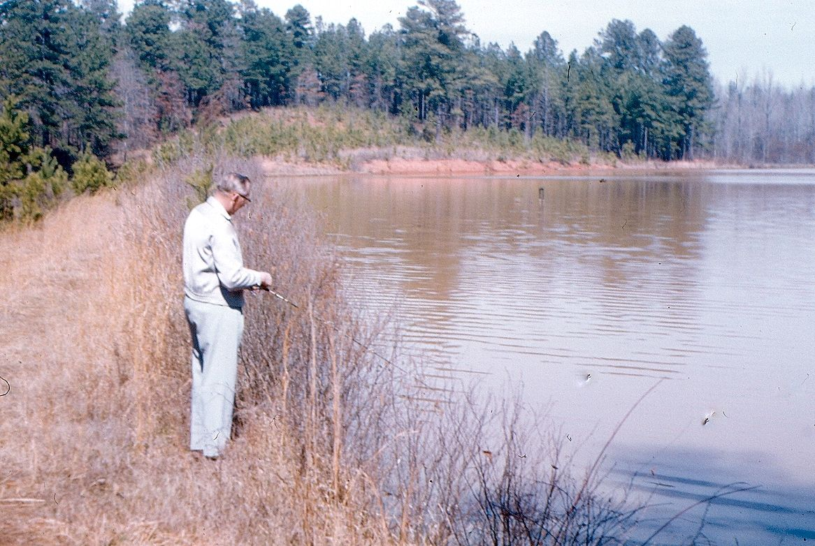 Daddy fishing on his 'farm' (off S. Hairston & Redan roads) A large property he & 3 other friends bought together in the mid 1940's (after WWII) so they could fish :o) When they sold the property in the 1960's, the development of Hidden Hills Country Club was built. The golf course is now closed & in ruins...SO strange & very sad to me now to see it this way!! And we drive by it a lot when working :o/   So so sad....