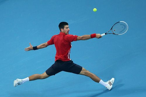 Novak Djokovic returns a shot to Michael Berrer during the Day 4...