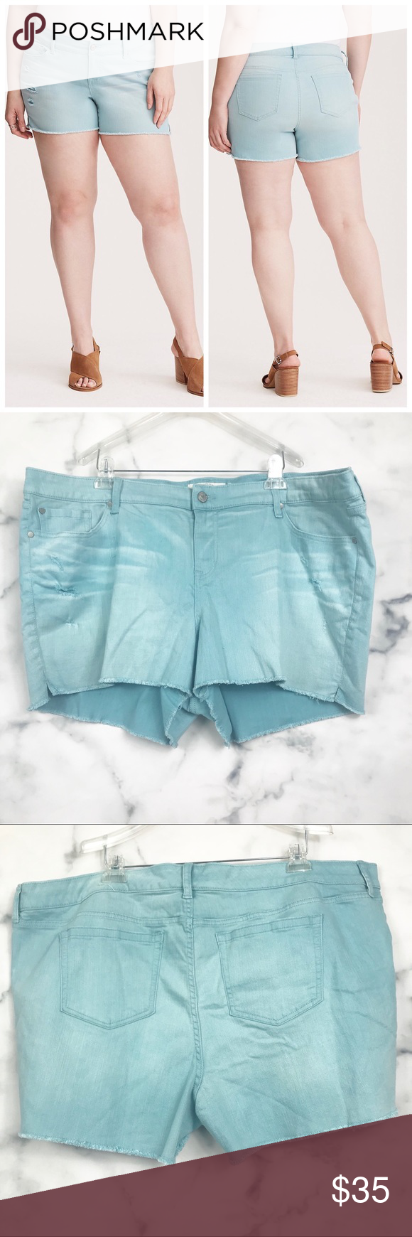 "Torrid Distressed Light Blue Denim Shorts Torrid Distressed Light Blue Denim Shorts 26 -Light blue wash with distressing  -Zipper with button fly -Raw frayed hem -Condition: Preowned. No flaws. No signs of wear.  Measurements lying flat: -Waist: 24"" -Rise: 12.5"" -Inseam: 3"" torrid Shorts #lightblueshorts"