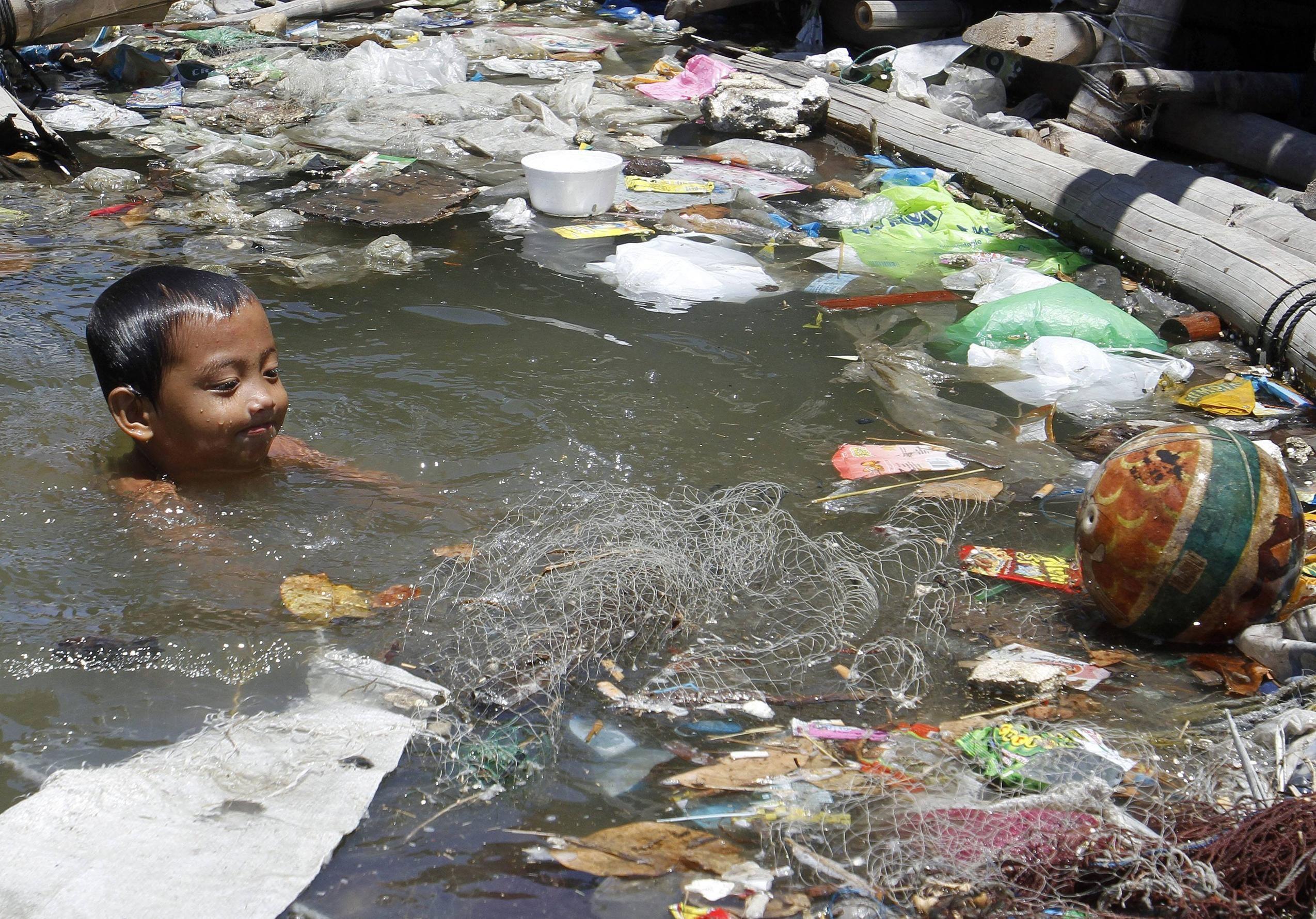 Kid Taking A Swim In The River Slums Pool Swimming