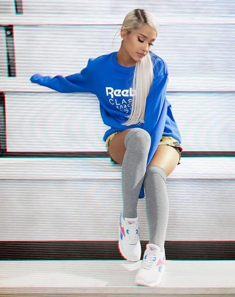 Ariana Grande sporting a classic Reebok sweatshirt | Ariana