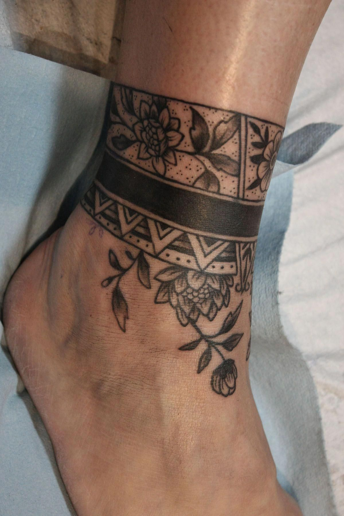 tattoo on foot Foottattoos Wrap around ankle tattoos