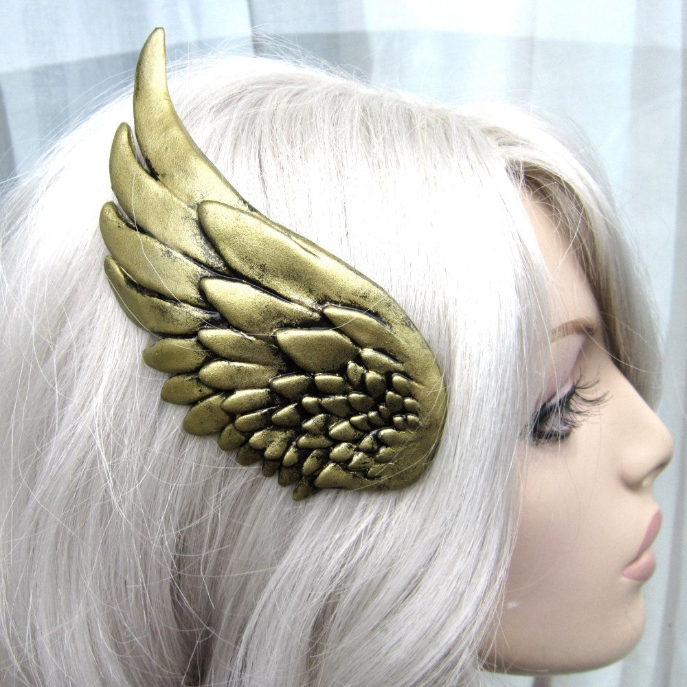 Don't even ask me when I'd ever wear it. I don't know either, but I want it. Gold Brass wing hair clip set - valkyrie, Thor, She ra, steampunk, cosplay. $49.00, via Etsy.
