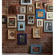 Love the bare brick wall with the colourful frames.