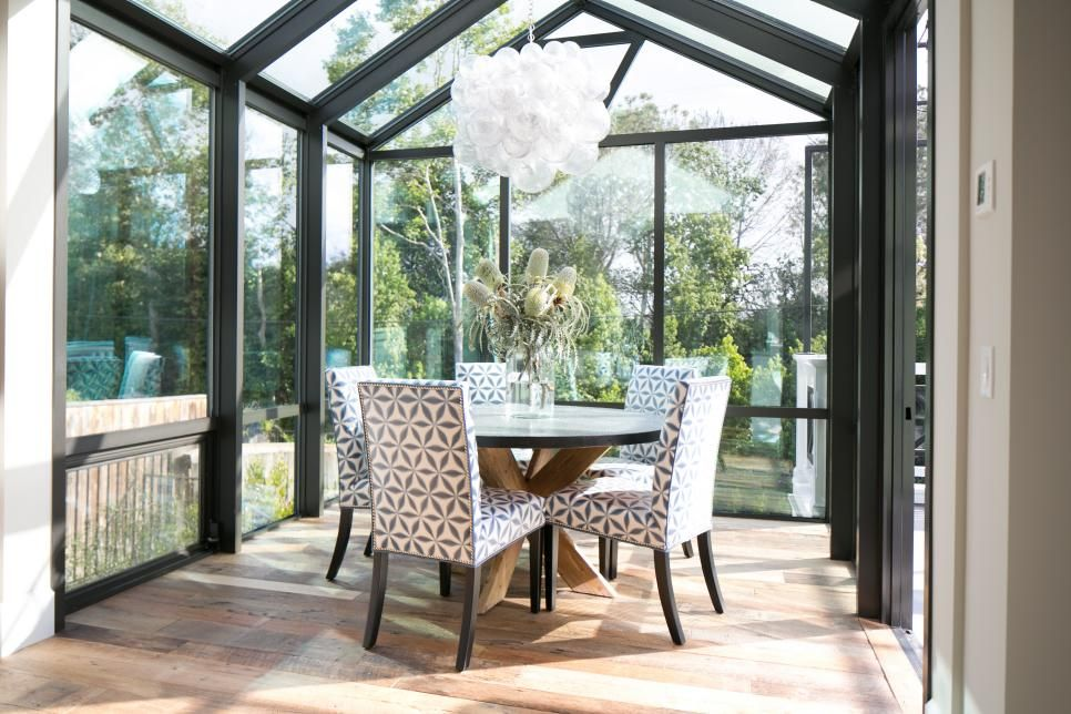 Dine With The Beauty Of Natural Surroundings But In The Comfort Of Air Conditioning In This Glass Sunroom Dining California Beach House Patterned Dining Chairs
