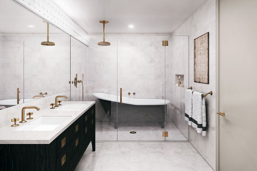 Marble bath, brass fixtures and freestanding tub in the shower ...
