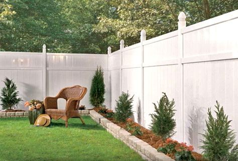 White vinyl fence with a small raised border. Very cute ...
