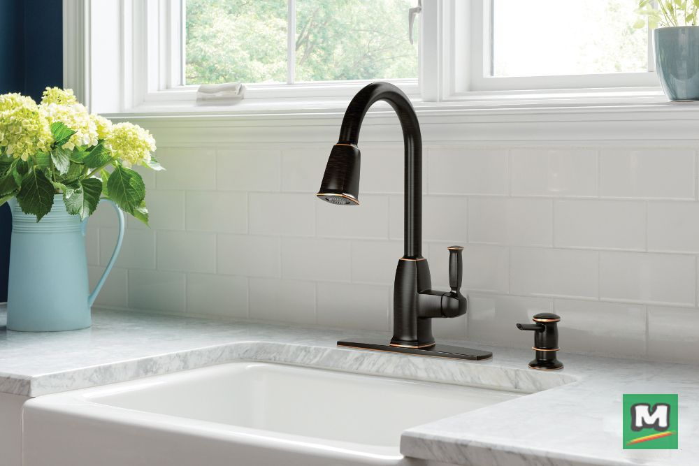 The Moen® Wellsley One-Handle Pull-Down Kitchen Faucet will work wonders in your kitchen! Equipped with a Reflex™ system, this faucet delivers smooth operation, easy movement and secure docking of the spray head. With the addition of a soap dispenser in the same Mediterranean Bronze Finish, this kitchen faucet will make everyday cleaning a breeze