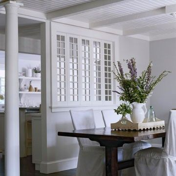 A Bank Of Tall And Narrow Multi Pane Windows Between The Kitchen Dining Room Makes Both Rooms Feel Lighter Airier Another Transitional Element