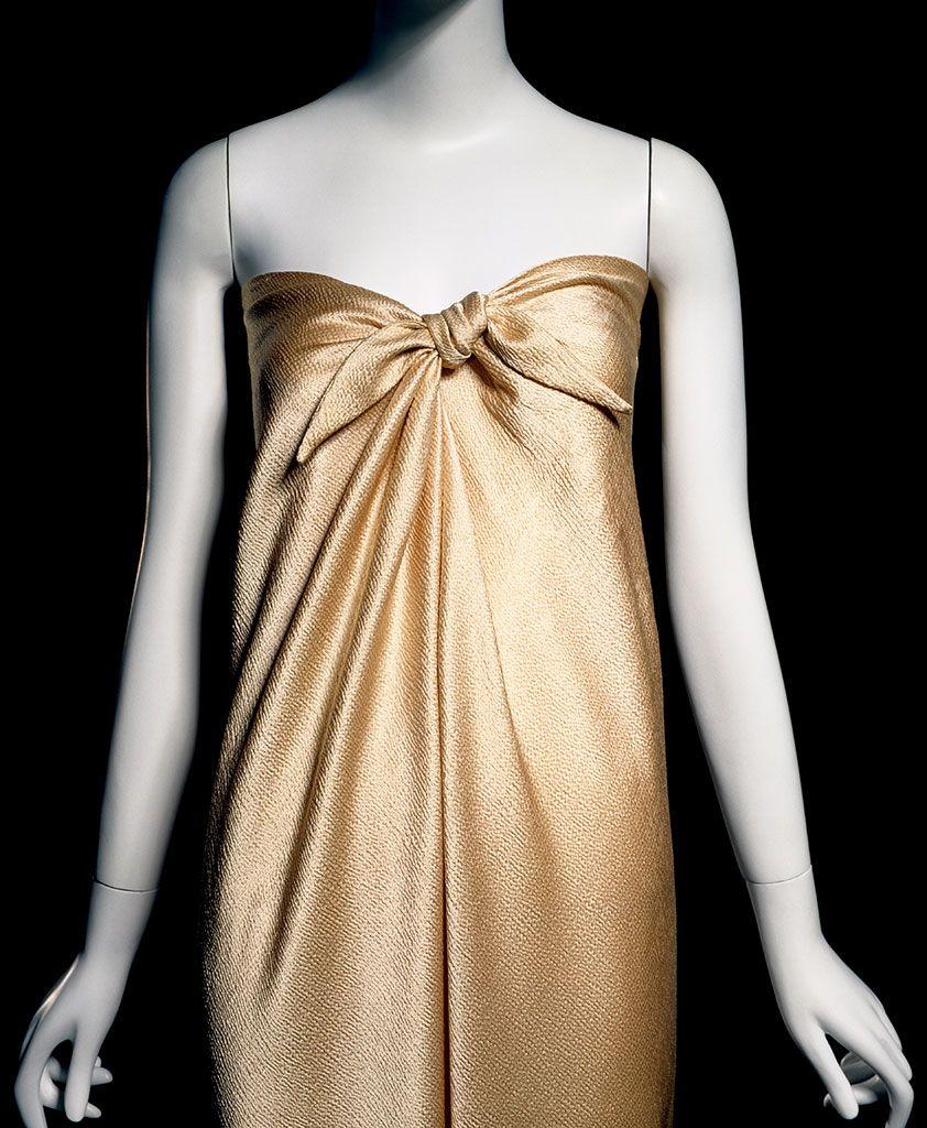 """detail) Halston, """"sarong"""" dress, gold hammered silk satin, 1976, USA ..."""
