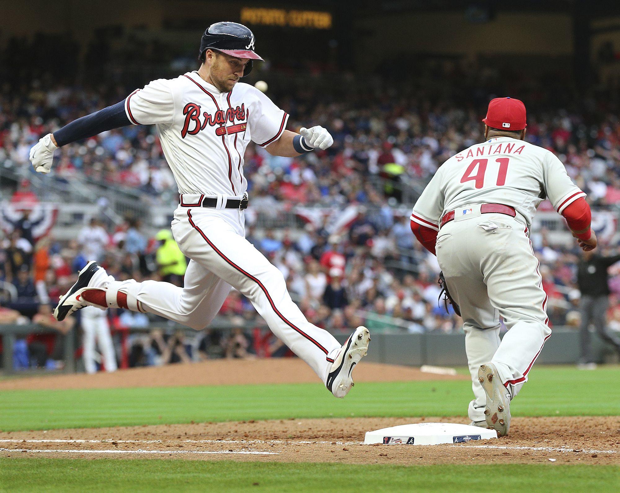 March 29 2018 Atlanta Atlanta Braves Outfielder Lane Adams Beats Out The Throw To Phillies First Baseman Carlos Sant Atlanta Braves The Outfield Mlb Baseball