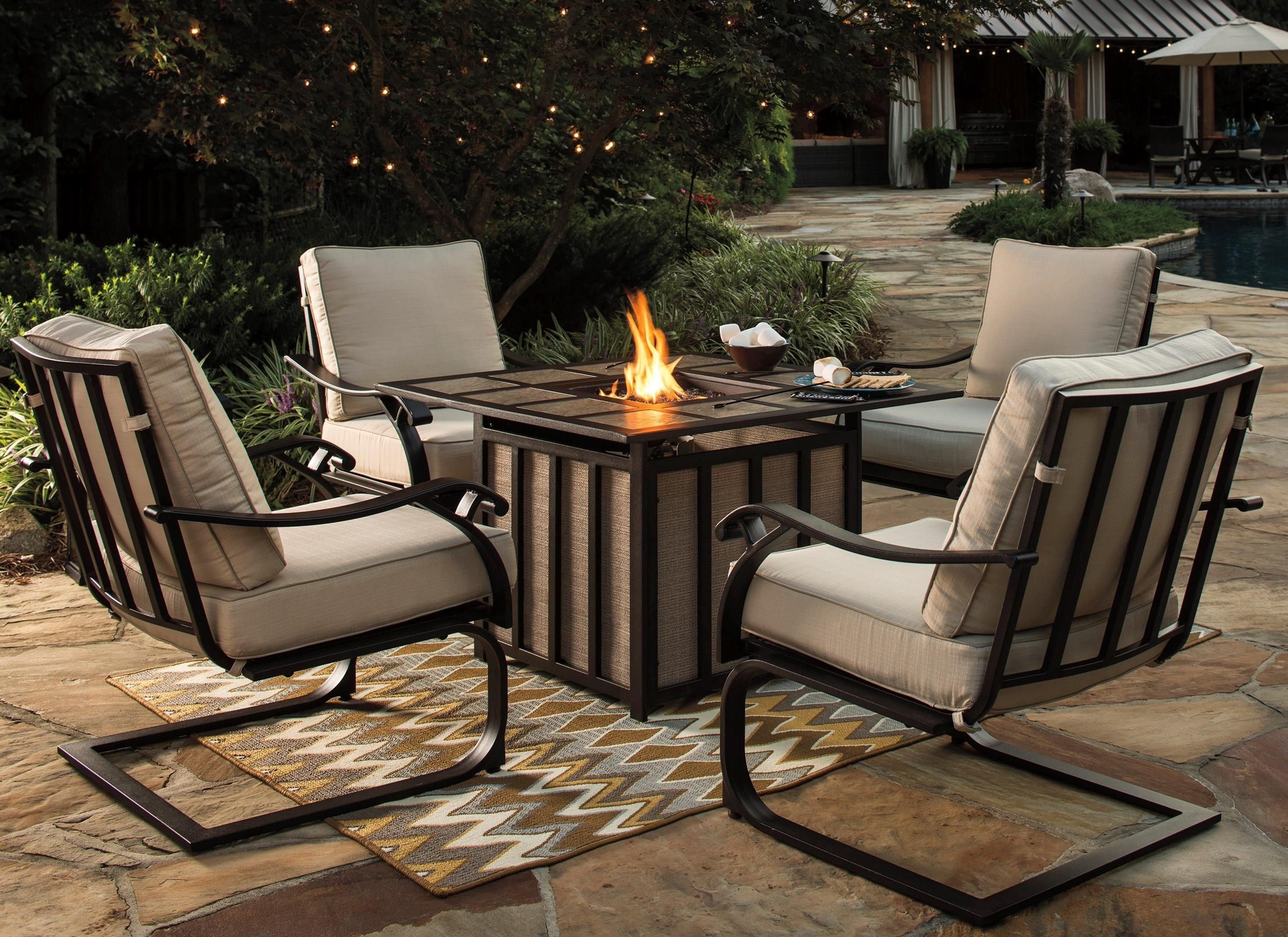Wandon Outdoor 5 Piece Fire Pit Table Set By Signature Design Ashley