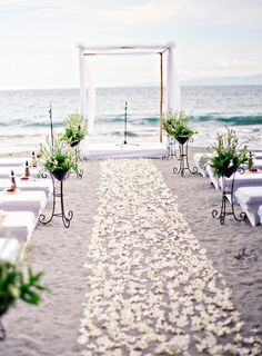 Frangipani strewn ceremony aisle for beach weddings