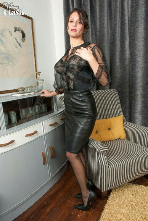 That's real milf flashing in leather coat can