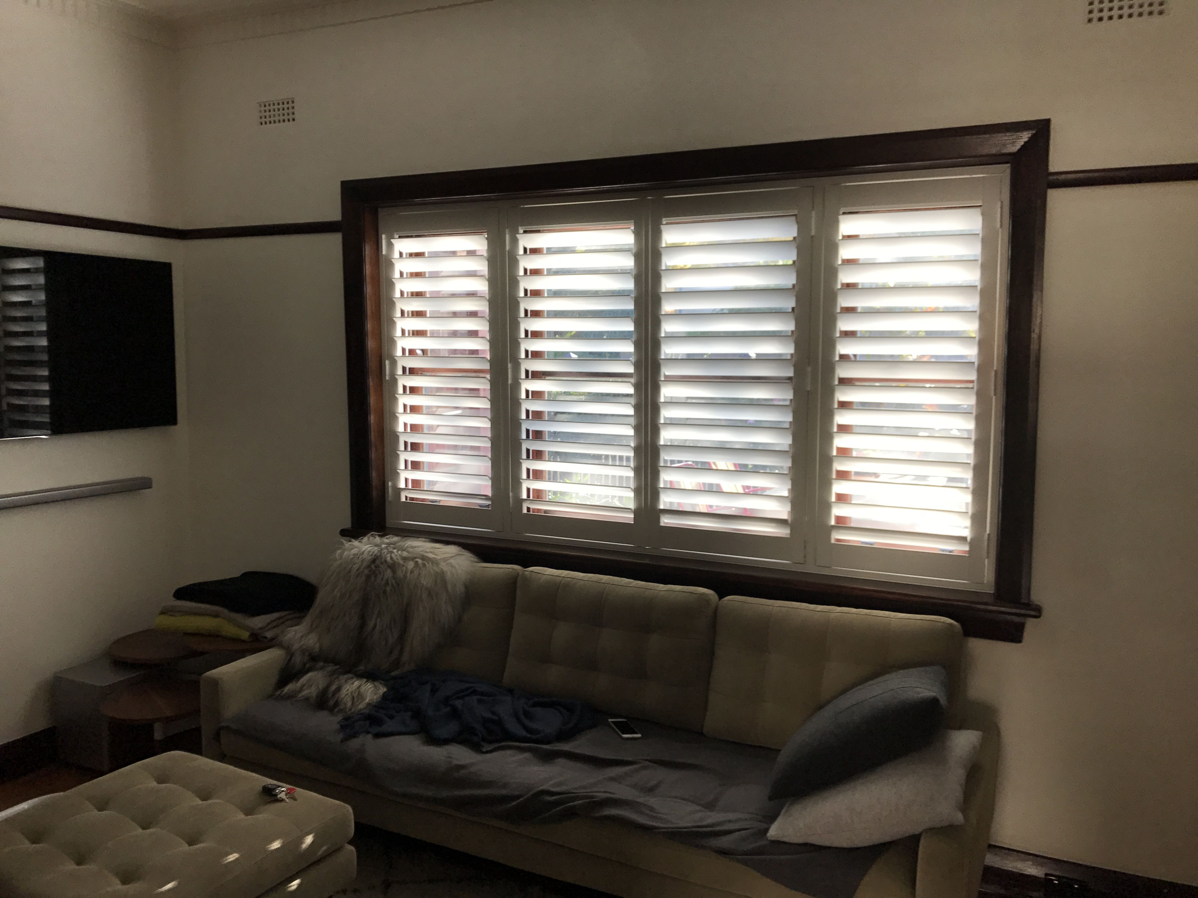 Plantation shutter dark timber deco lounge interior design