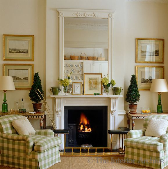 Todhunter Earle Interiors A Pair Of Armchairs Upholstered In Green And Cream Checked Fabric Flank The Firep Home Living Room Family Room Design Family Room