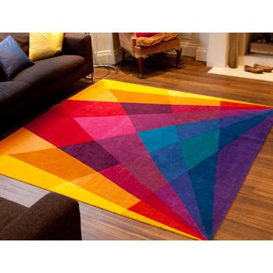 One colourful rug can change the ambiance of the room.