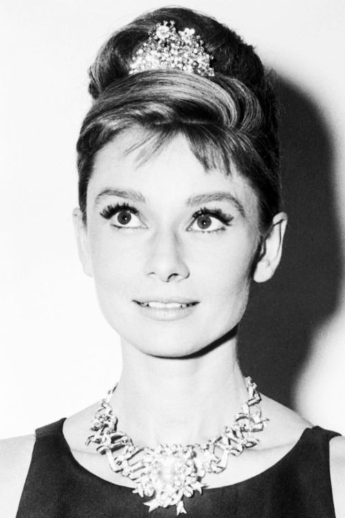 32ad03181 Audrey Hepburn wearing the Yellow Tiffany Diamond for the publicity of  Breakfast at Tiffany's, released in 1961