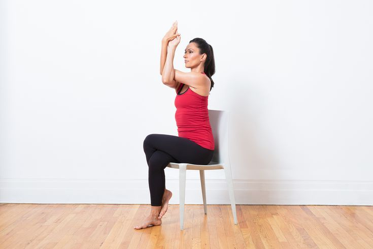 10 Yoga Poses You Can Do In A Chair Yoga Poses Chair Pose Yoga Yoga Postures