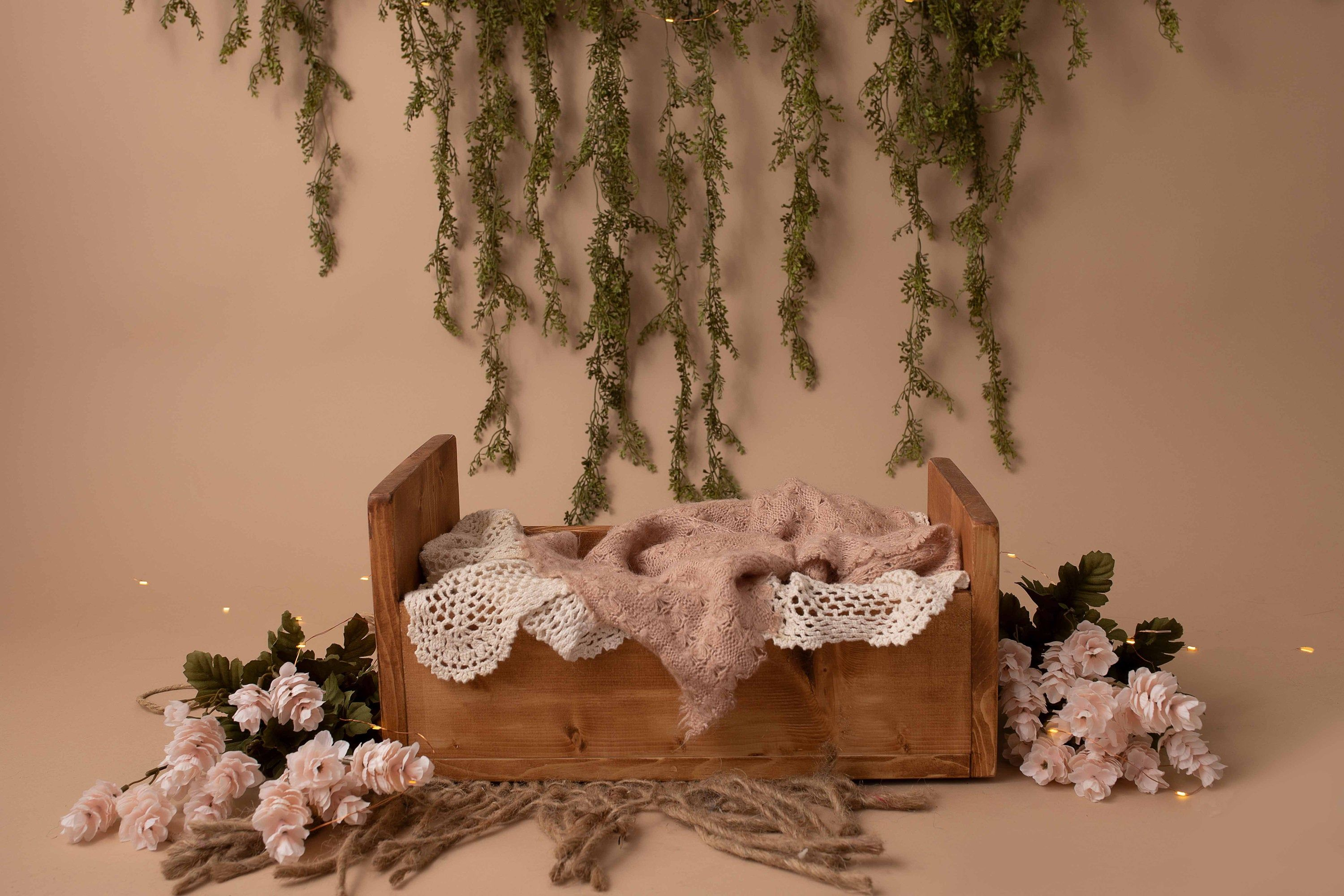 Simple Wooden Bed with Greenery, Flowers, and Twinkle