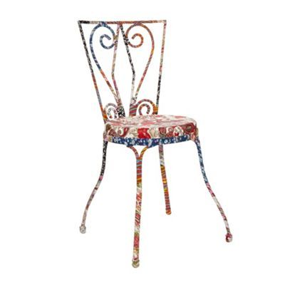 This decorative chair from our own range has a fabric covered design with a mixture of patterns and colours.