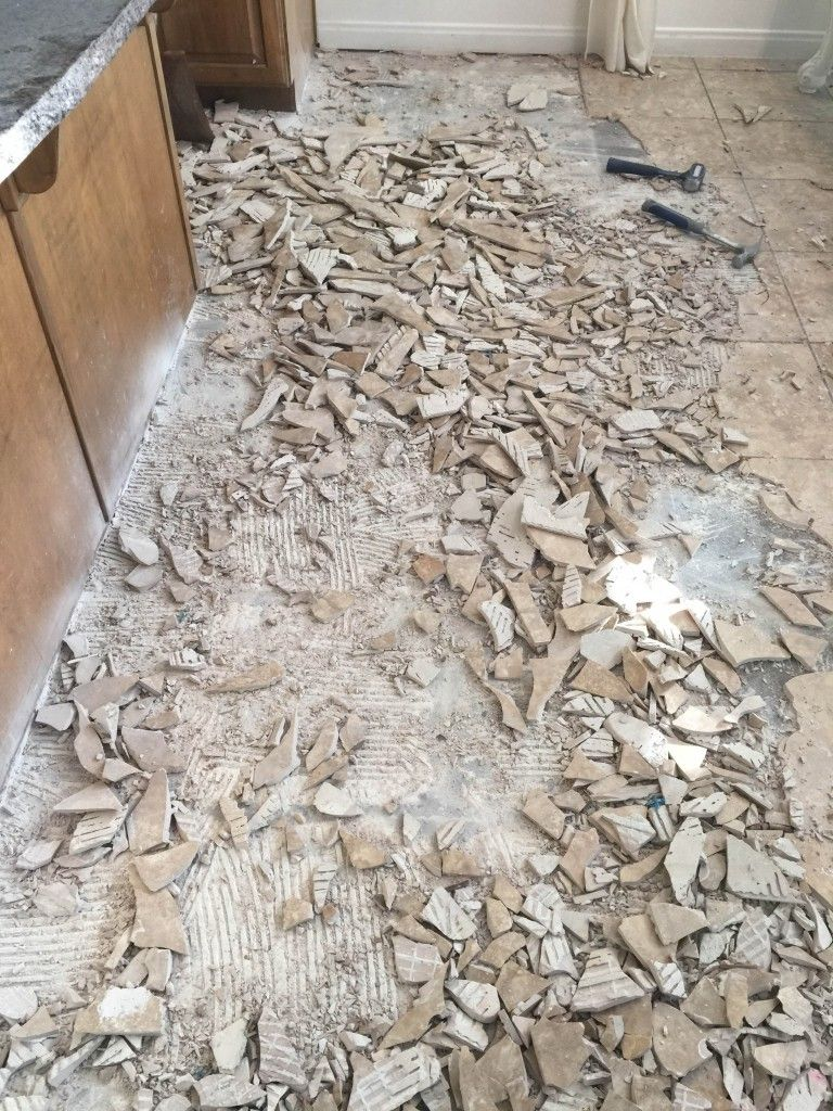 How To Remove Tile Flooring Yourself With Tips And Tricks Tile Removal Diy Flooring Diy Remodel