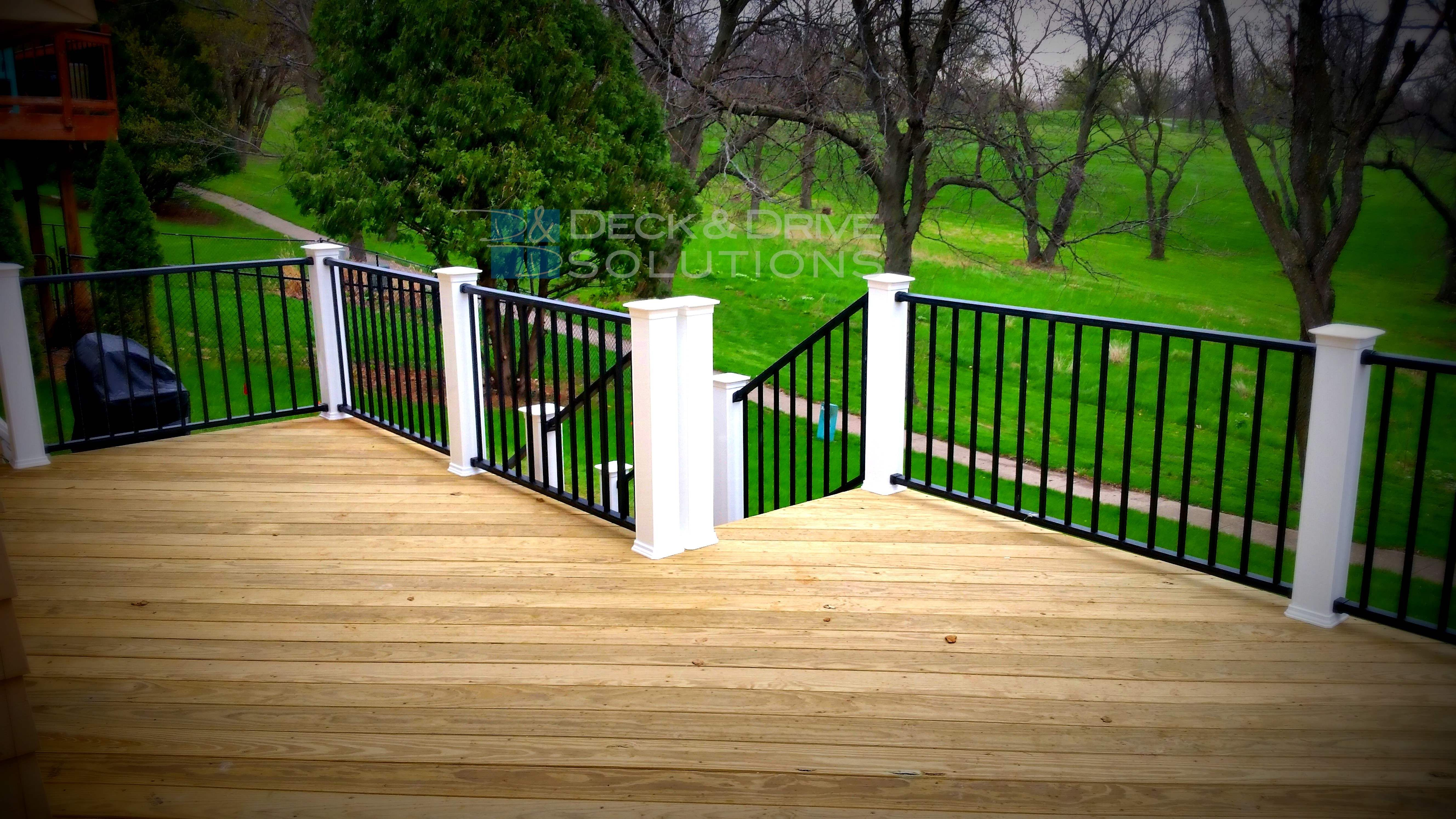 Best Treated Deck With Black Westbury Railing And White Posts 640 x 480