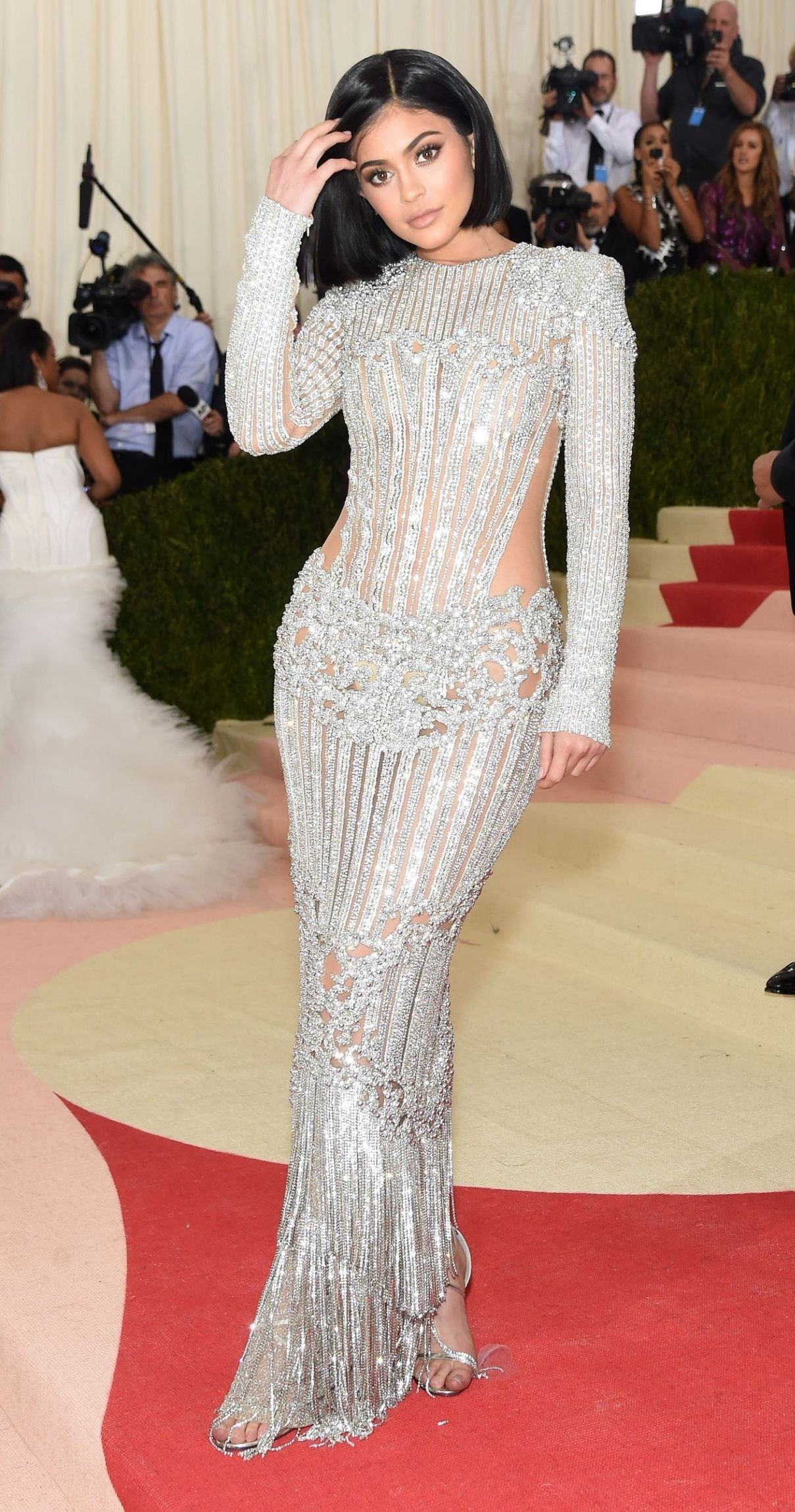 5ba38bf5115 Kylie Jenner In a Silver Balmain Dress at the 2016 Met Gala    See What