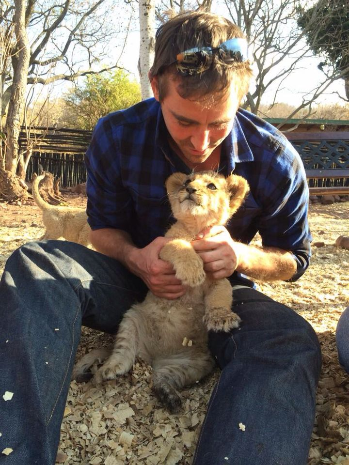 Lee Pace with a lion cub