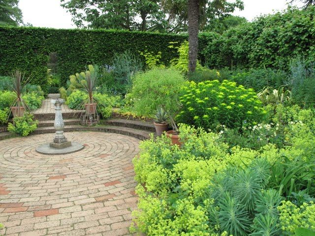 Circular patio surrounded by a golden green garden ~ I love it