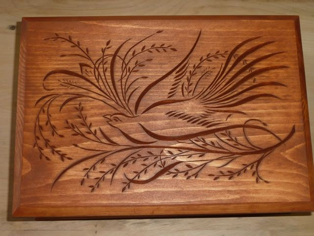 Chip carved dove on lid of wooden jewelry box all things