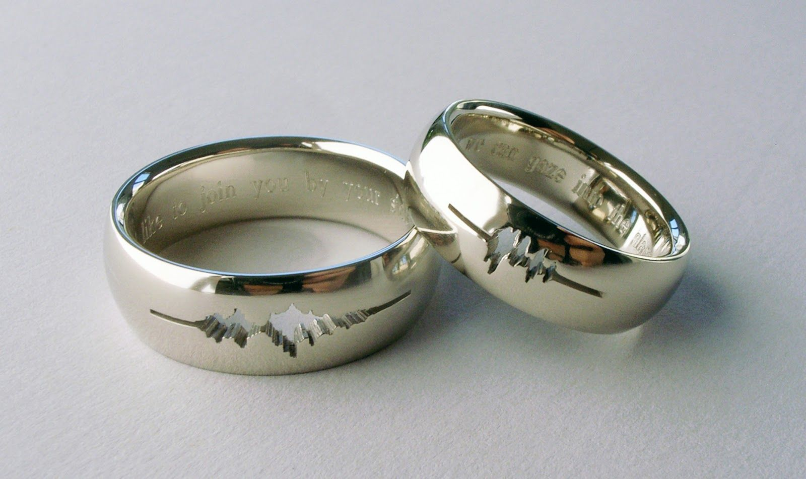 Wedding rings engraved with a waveform of the couples own voices