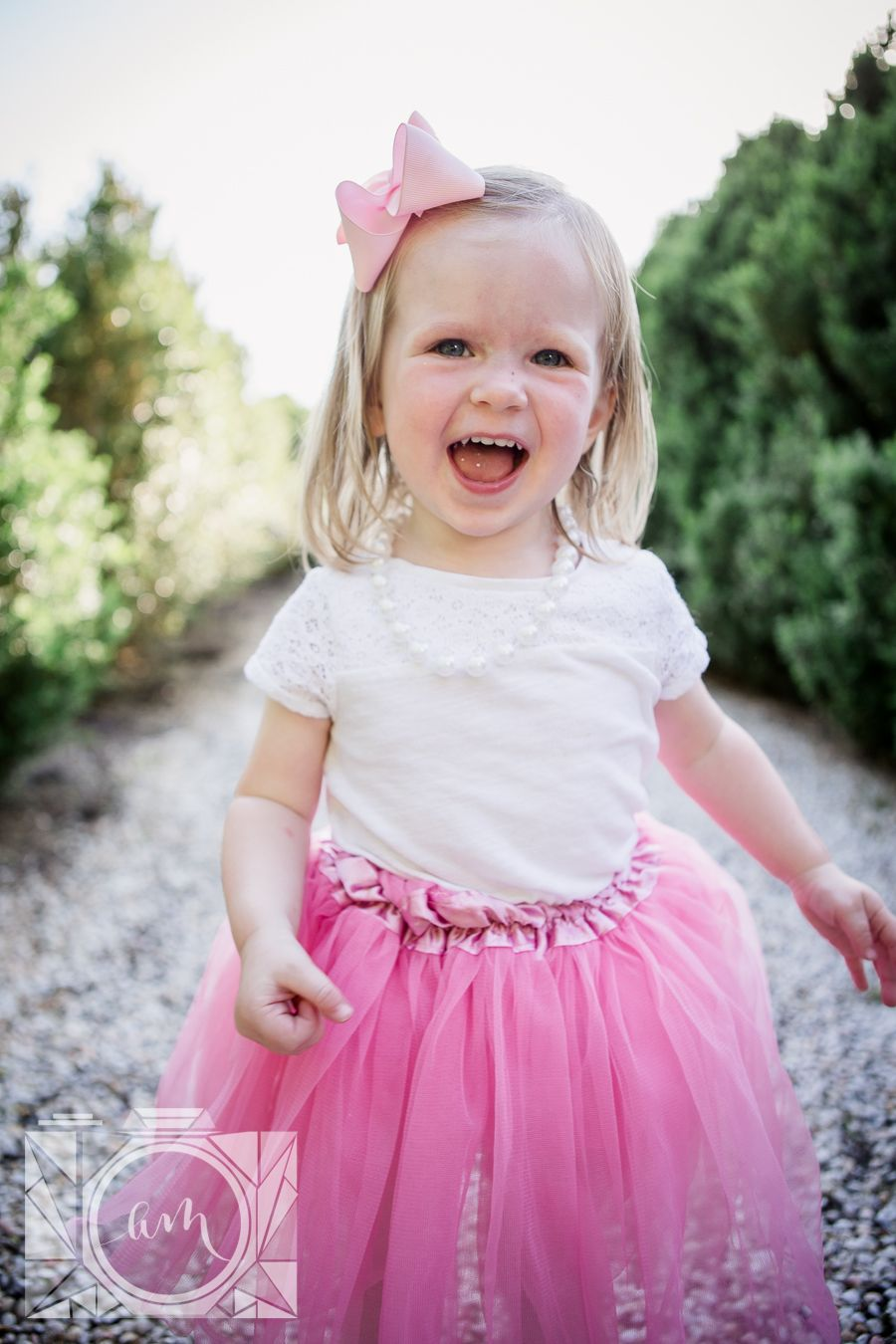 Little girl smiling at camera at this family session at Baxter Gardens in Fountain City by Knoxville Wedding Photographer, Amanda May Photos