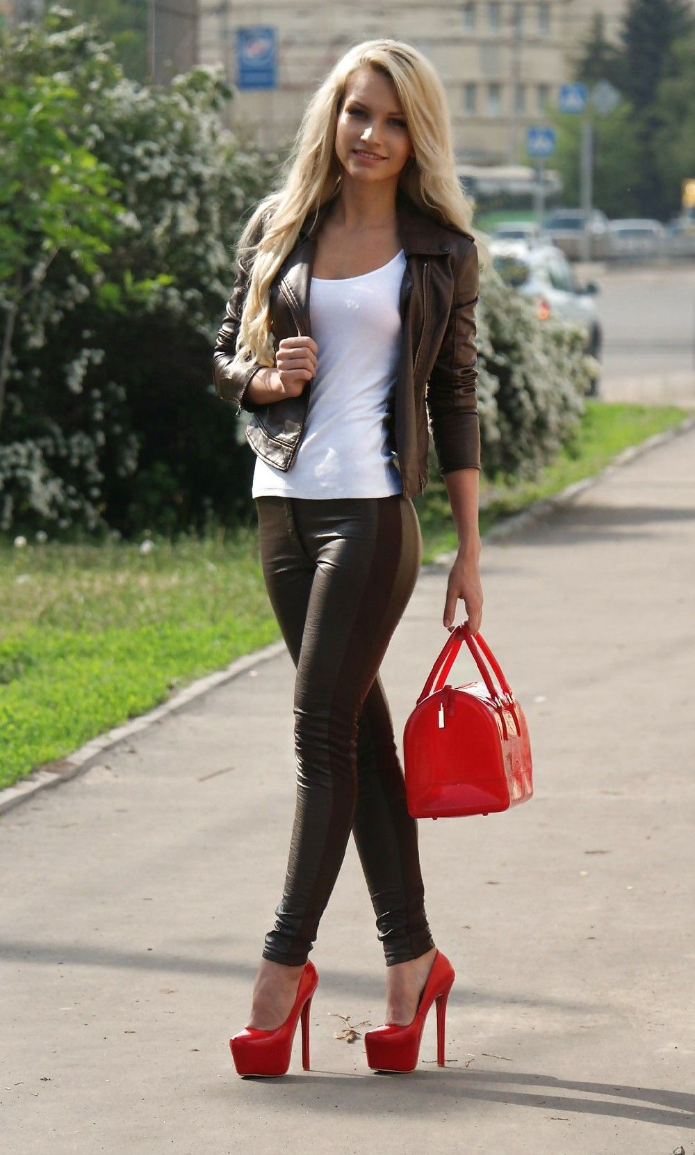 Leather pants and a jacket with white shirt and red heels. Would like the shoes without the platform heel and lose the huge bag though.