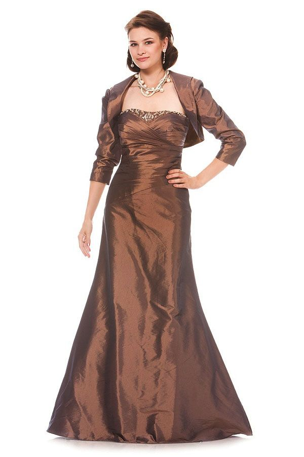 Strapless full length gown with beading along the center of the bust area. This gown includes a matching bolero.
