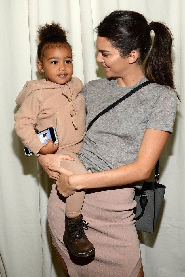 Kendall Jenner carrying the new It bag of the season from Michael Kors