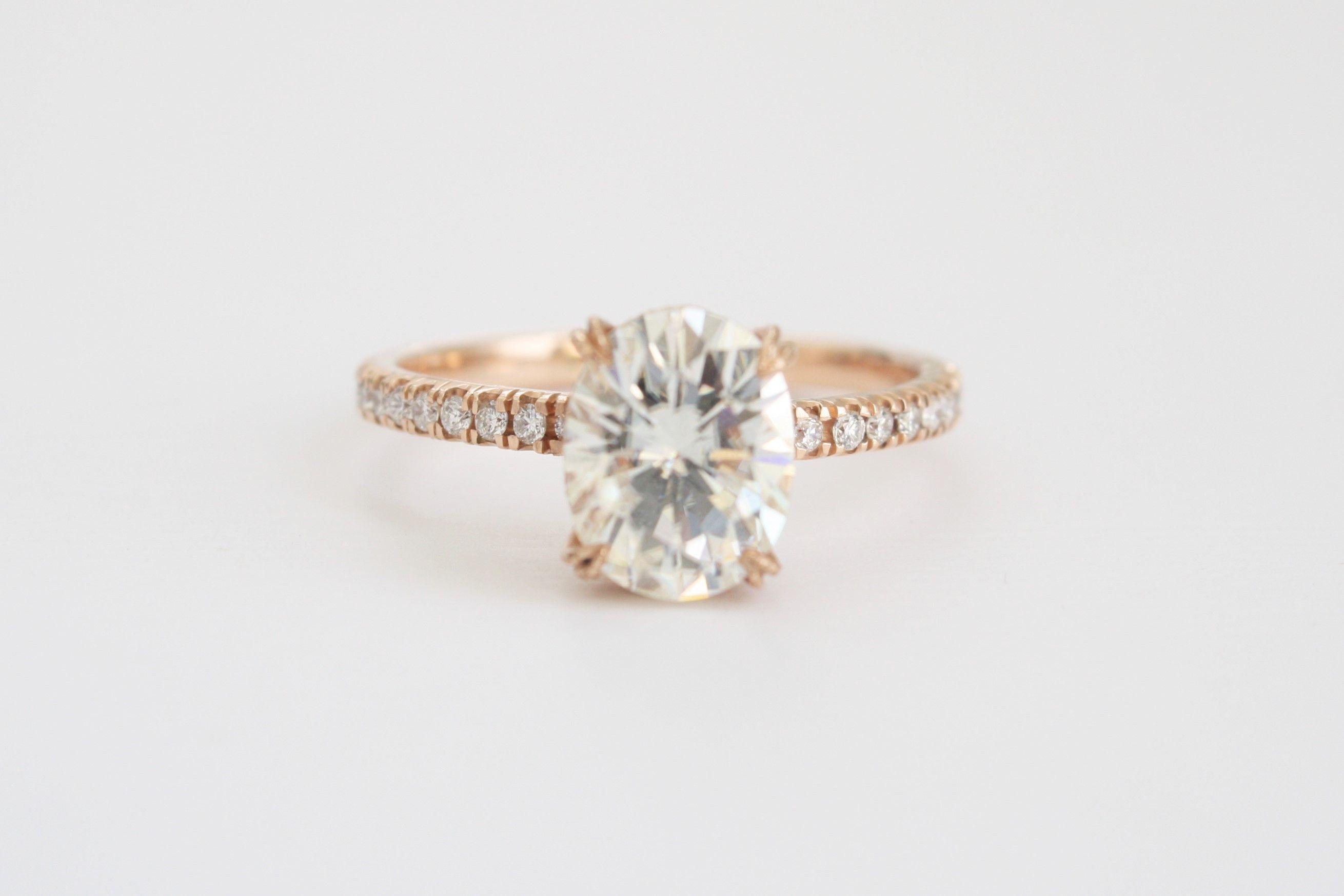 Oval forever brilliant moissanite solitaire diamond engagement ring