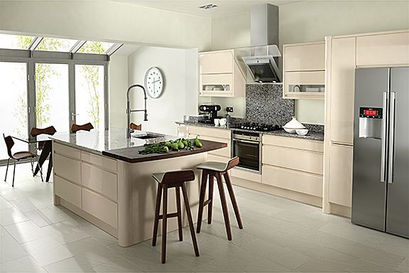 The focal point of this Remo Beige #kitchen is the #island, incorporating a stylish tap and undermounted sink