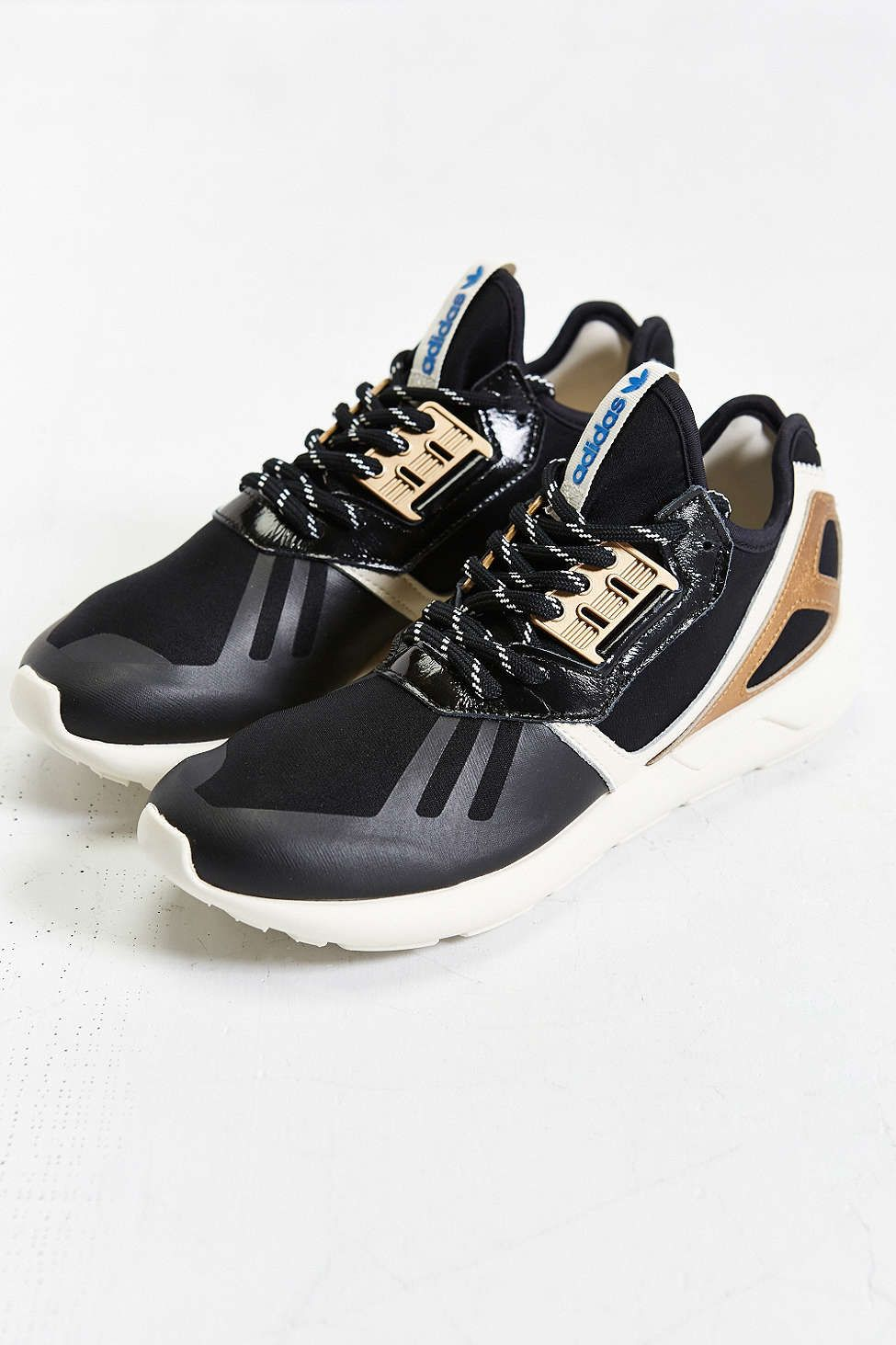 Jonathan need black/gold sneakers... I wonder if he would like these???  adidas Originals Tubular Metallic Running Sneaker
