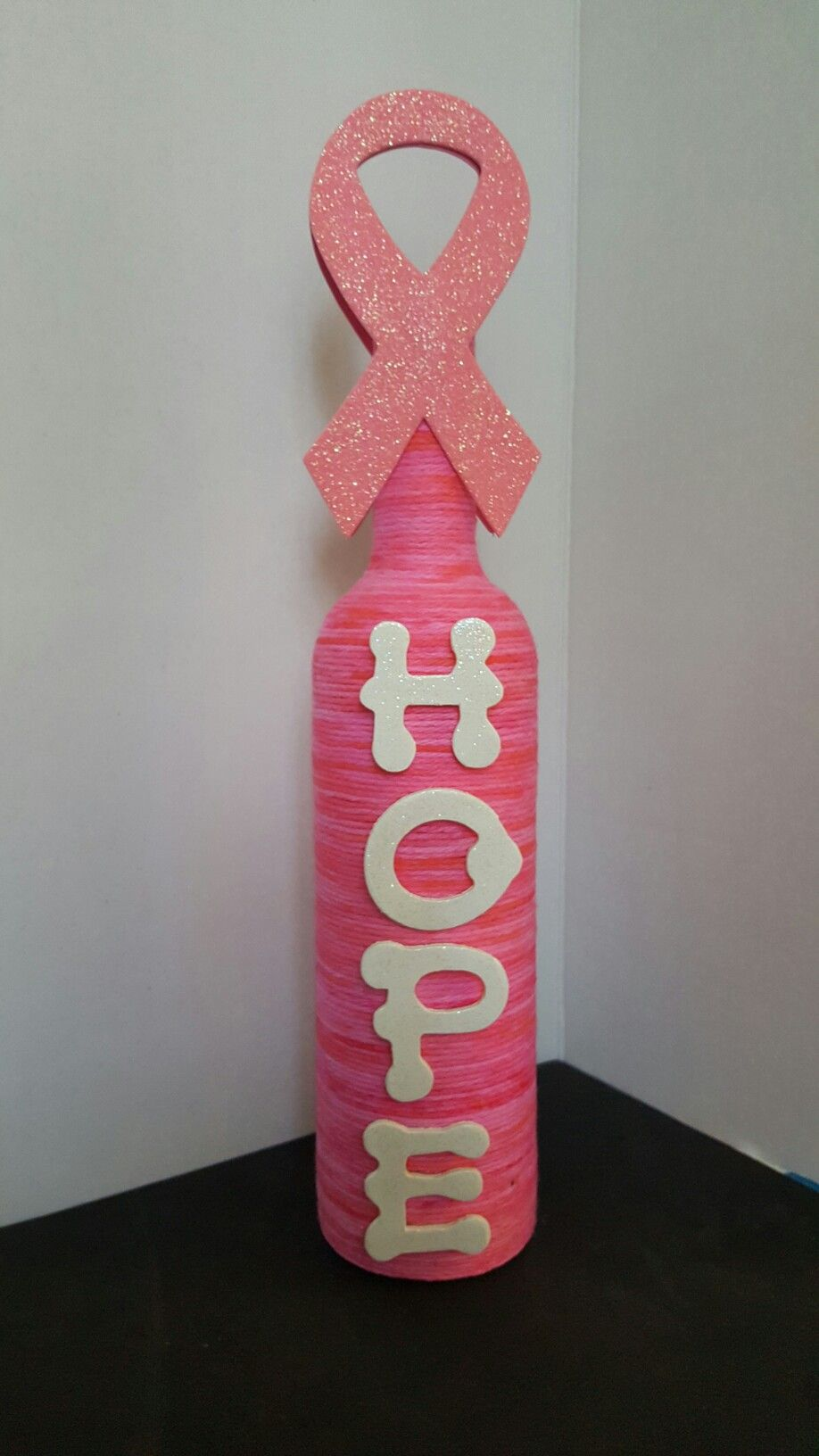 Bottle wrapped in yarn dyed with food coloring with Hope, and breast ...