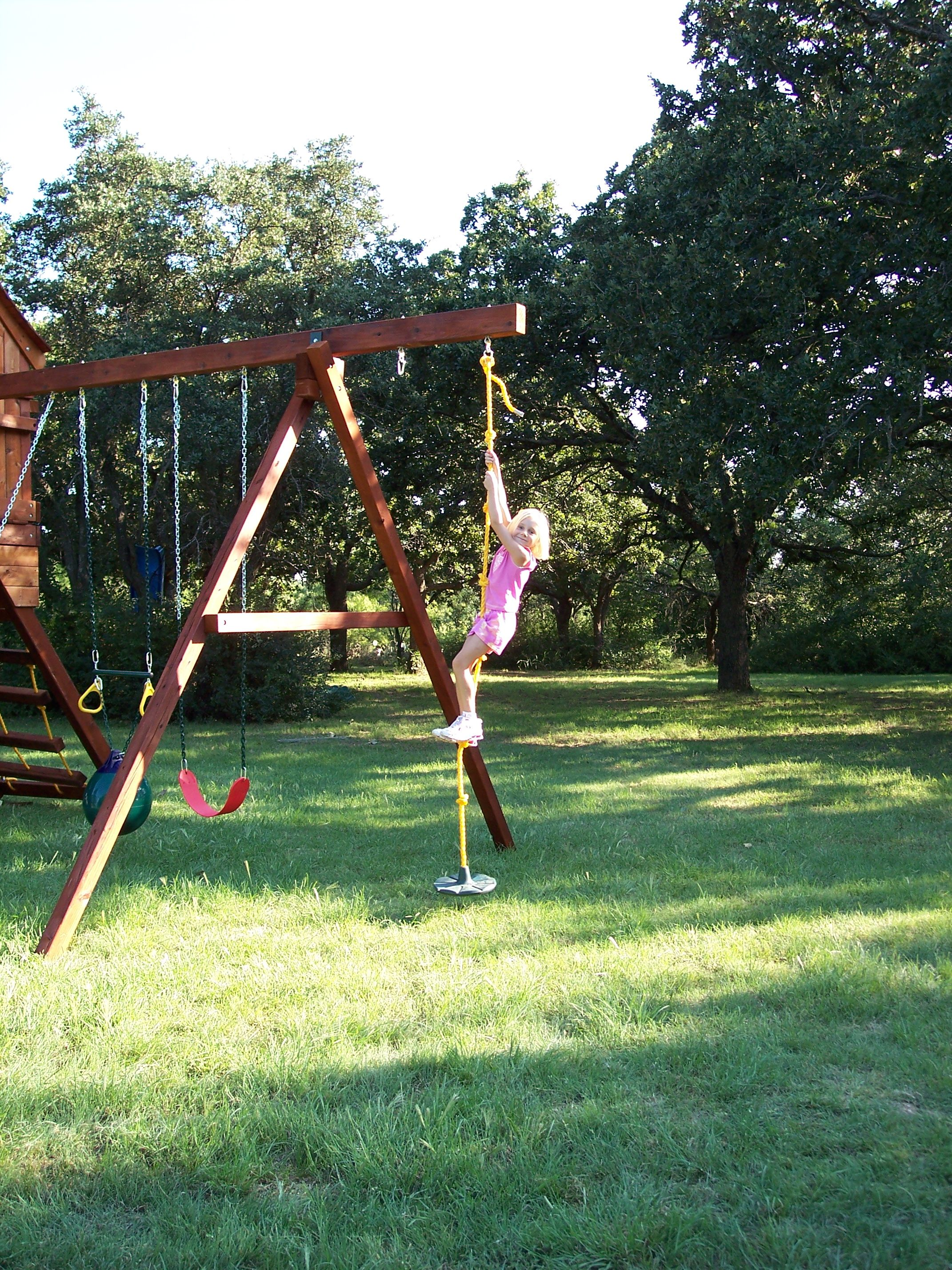 Daisy Disc With Knotted Rope Is The Perfect Swing Addition To Your Backyard Playset Swing Set Or Tree Swing This Daisy Di Backyard Playset Swing Set Backyard